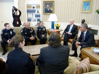 President Barack Obama and Vice President Joe Biden meet with rank-and-file law enforcement officials in the Oval Office of the White House on Feb. 24, 2015, in Washington. (Photo by Olivier Douliery-Pool/Getty Images)