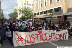 Protesters rally during a march after hearing the police officer who shot Tony Robinson would not be charged Tuesday, May 12, 2015, in Madison, Wis. District Attorney Ismael Ozanne, said he won't file charges against Officer Matt Kenny in the death of Robinson, an unarmed 19-year-old biracial man. (AP photo/Carrie Antlfinger)