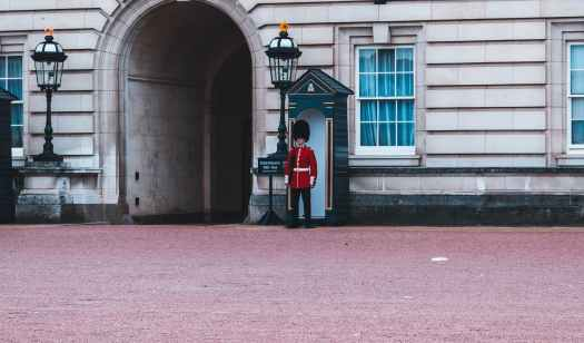 royal guard standing beside building